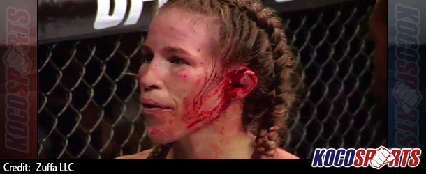 Mick Foley offers support to UFC's Leslie Smith whose ear exploded and was almost torn off