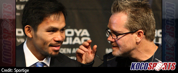 Freddie Roach says there is more pressure on Floyd Mayweather than Manny Pacquiao
